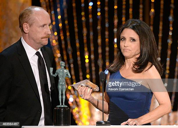 Actress Julia Louis-Dreyfus accepts the Outstanding Performance by a Female Actor in a Comedy Series award for 'Veep' with actor Matt Walsh onstage...