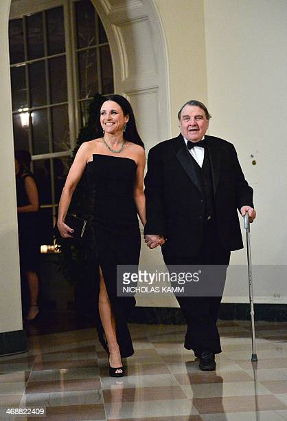 Actress Julia LouisDreyfus and her father William LouisDreyfus arrive at the White House in Washington on February 11 2014 for the state dinner in...