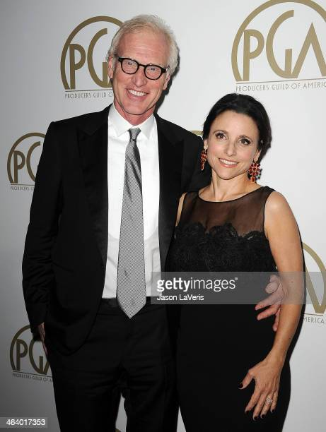 Actress Julia LouisDreyfus and husband Brad Hall attend the 25th annual Producers Guild Awards at The Beverly Hilton Hotel on January 19 2014 in...