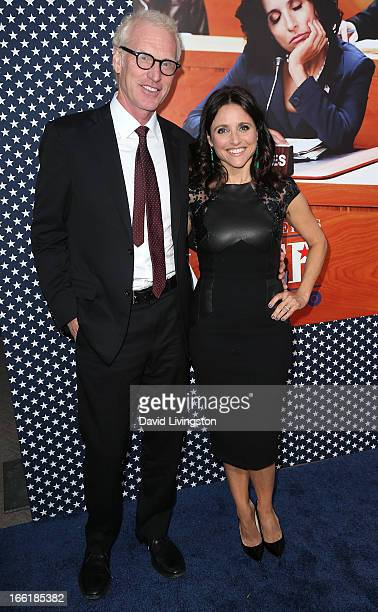 Actress Julia LouisDreyfus and husband writer Brad Hall attend the premiere of HBO's 'VEEP' Season 2 at Paramount Studios on April 9 2013 in...