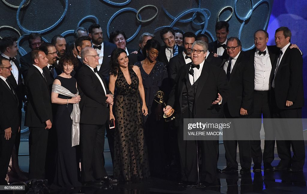 Actress Julia Louis-Dreyfus (center L) and producer David Mandel (4R) and the cast and crew accept the award for Outstanding Comedy Series for 'Veep' during the 68th Emmy Awards show on September 18, 2016 at the Microsoft Theatre in downtown Los Angeles. / AFP / Valerie MACON