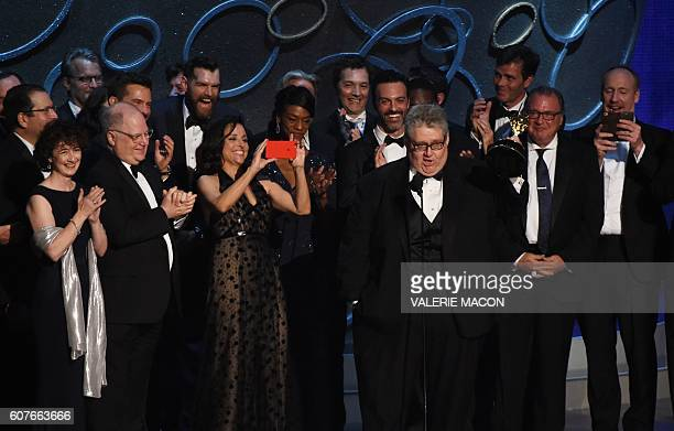 TOPSHOT Actress Julia LouisDreyfus and producer David Mandel and the cast and crew accept the award for Outstanding Comedy Series for 'Veep' during...