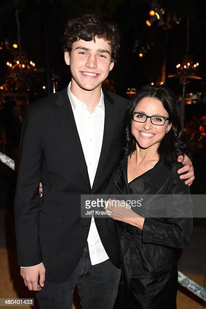 Actress Julia LouisDreyfus and son Charles Hall attend the VEEP season 3 premiere at Paramount Studios on March 24 2014 in Hollywood California