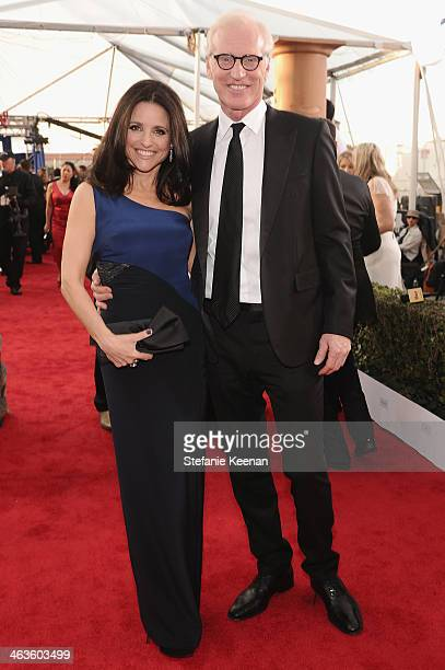 Actress Julia LouisDreyfus and writer Brad Hall attends 20th Annual Screen Actors Guild Awards at The Shrine Auditorium on January 18 2014 in Los...
