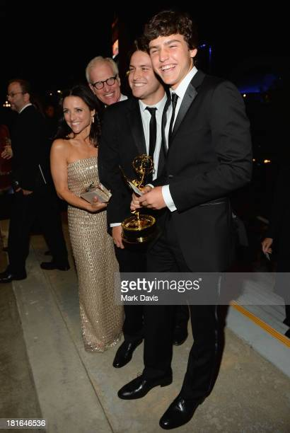Actress Julia LouisDreyfus husband Brad Hall and sons Charles and Henry attend the Governors Ball during the 65th Annual Primetime Emmy Awards at...