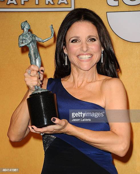 Actress Julia LouisDreyfus poses in the press room at the 20th annual Screen Actors Guild Awards at The Shrine Auditorium on January 18 2014 in Los...