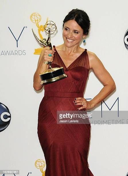 Actress Julia LouisDreyfus poses in the press room at the 64th Primetime Emmy Awards at Nokia Theatre LA Live on September 23 2012 in Los Angeles...