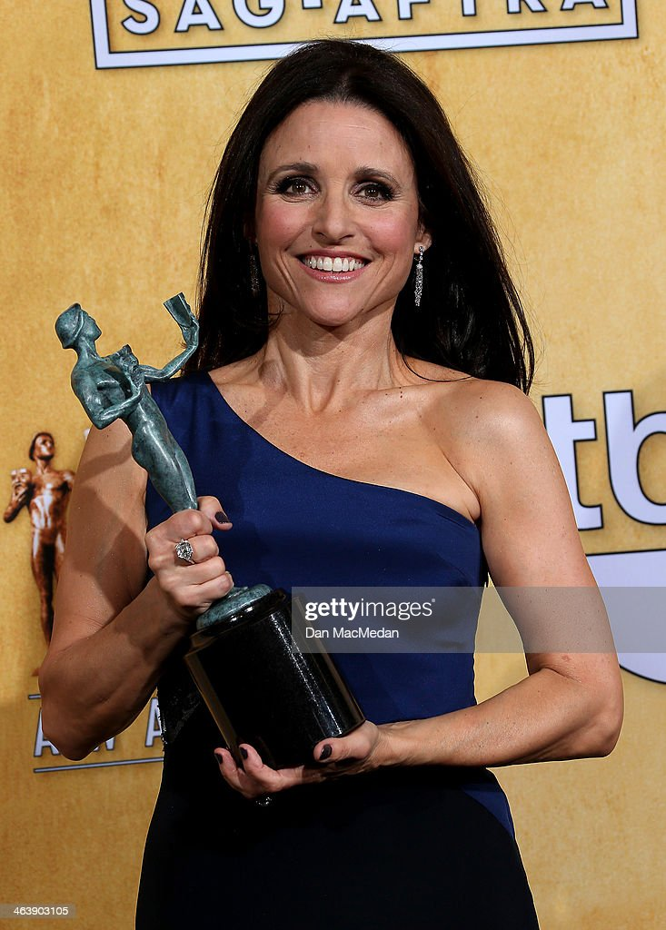 Actress Julia Louis-Dreyfus poses in the press room with the award for Outstanding Performance by a Female Actor in a Comedy Series for 'Veep' at the 20th Annual Screen Actors Guild Awards at the Shrine Auditorium on January 18, 2014 in Los Angeles, California.
