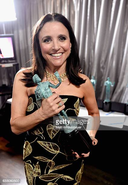 Actress Julia LouisDreyfus poses in the press room with the award for Best Female Actor in a Comedy Series for 'Veep' during The 23rd Annual Screen...