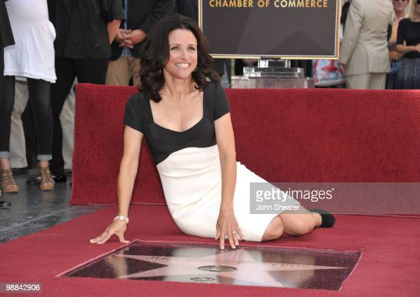 Actress Julia LouisDreyfus poses on her star at her Hollywood Walk of Fame ceremony on May 4 2010 in Hollywood California