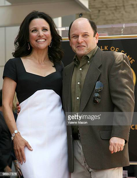 Actress Julia LouisDreyfus poses with actor Jason Alexander at the Hollywood Walk of Fame ceremony honoring Julia LouisDreyfus on May 4 2010 in...
