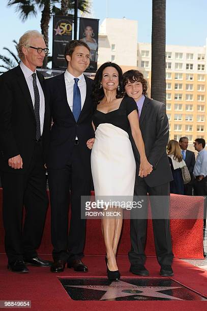 Actress Julia LouisDreyfus poses with her family at her Walk of Fame star ceremony in the Hollywood section of Los Angeles May 4 2010 From left are...