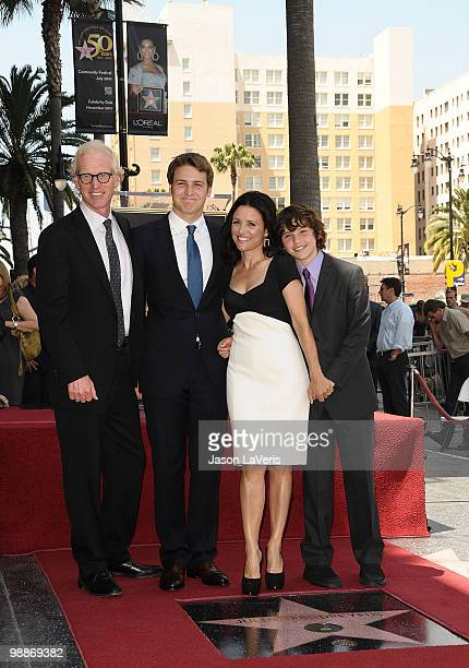 Actress Julia LouisDreyfus poses with her husband Brad Hall and sons Henry Hall and Charles Hall at her induction into the Hollywood Walk of Fame on...