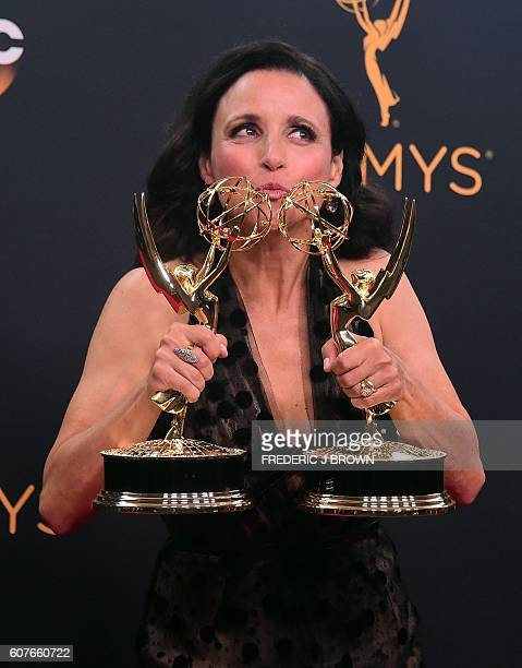 Actress Julia Louis-Dreyfus poses with the Emmys for Outstanding Comedy Series and Oustanding Lead Actress in a Comedy Series, in the press room...