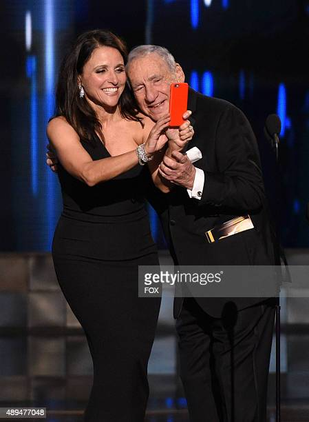Actress Julia LouisDreyfus takes a selfie with presenter Mel Brooks as she accepts Outstanding Comedy Series award for 'Veep' onstage during the 67th...