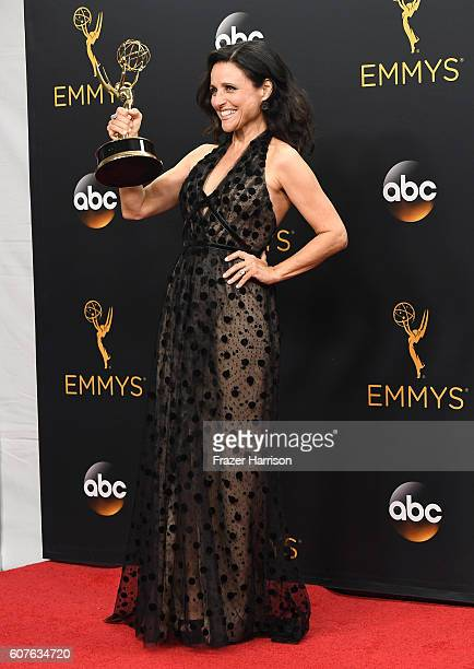 Actress Julia LouisDreyfus winner of Best Actress in a Comedy Series for Veep poses in the press room during the 68th Annual Primetime Emmy Awards at...
