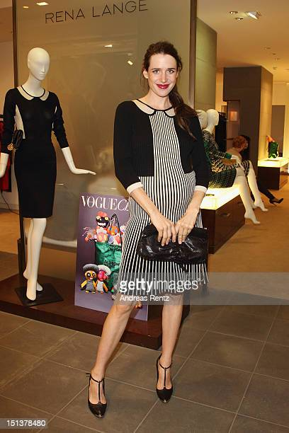 Actress Julia Malik attends in a 'The Sparkle' knitdress the 'Vogue Fashion Night Out' Berlin at Rena Lange store on September 6 2012 in Berlin...