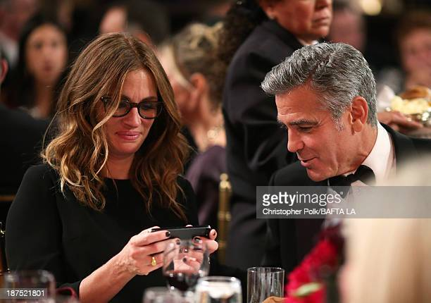 Actress Julia Roberts and actor George Clooney attend the 2013 BAFTA LA Jaguar Britannia Awards presented by BBC America at The Beverly Hilton Hotel...