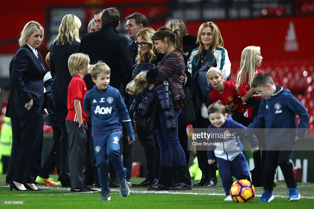 Actress Julia Roberts and Coleen Rooney talk after the Premier League match between Manchester United and West Ham United at Old Trafford on November 27, 2016 in Manchester, England.