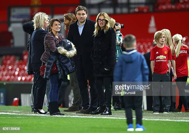 Actress Julia Roberts and Coleen Rooney talk after the Premier League match between Manchester United and West Ham United at Old Trafford on November...