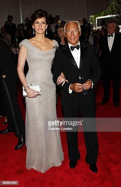 Actress Julia Roberts and designer Giorgio Armani arrive at the Metropolitan Museum of Art Costume Institute Gala Superheroes Fashion and Fantasy...
