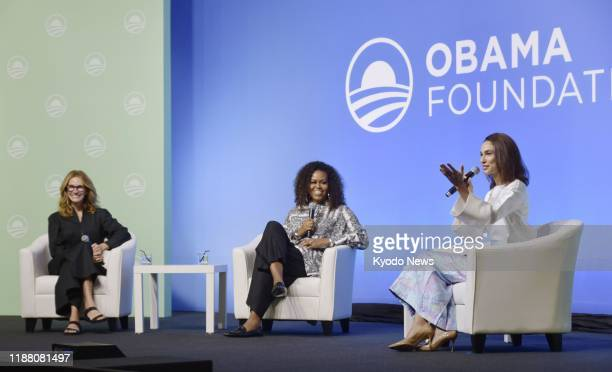 Actress Julia Roberts and former U.S. First Lady Michelle Obama attend a roundtable in Kuala Lumpur on Dec. 12 where they called for the expansion of...