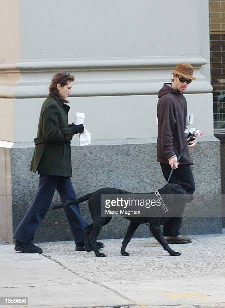 Actress Julia Roberts and her husband Danny Moder walk a dog November 24 2002 in New York City