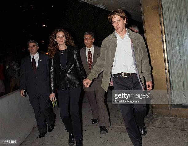 Actress Julia Roberts and husband Danny Moder leave the screening of PunchDrunk Love at Alice Tully Hall during the 10th Annual New York Film...