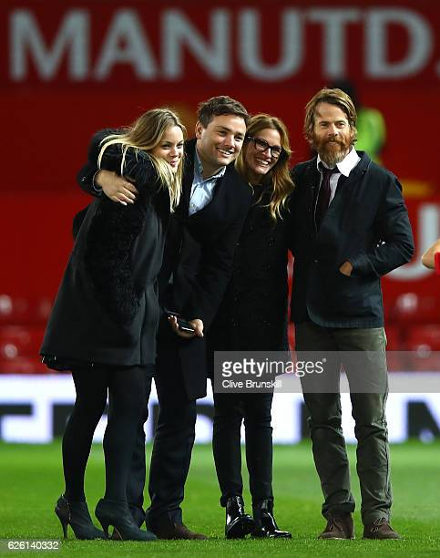 Actress Julia Roberts and husband Danny Moder pose on the pitch after the Premier League match between Manchester United and West Ham United at Old...