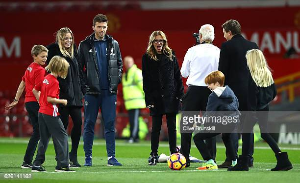 Actress Julia Roberts and Michael Carrick of Manchester United talk after the Premier League match between Manchester United and West Ham United at...