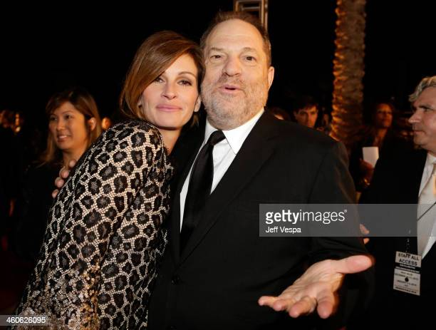 Actress Julia Roberts and producer Harvey Weinstein arrive at the 25th annual Palm Springs International Film Festival awards gala at Palm Springs...