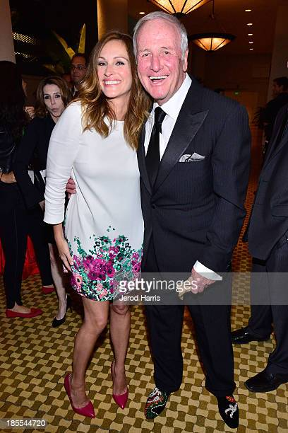 Actress Julia Roberts and producer Jerry Weintraub celebrate with Mot Chandon at the 17th Annual Hollywood Film Awards Gala at The Beverly Hilton...