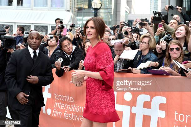 """Actress Julia Roberts arrives at the """"August: Osage County"""" Premiere during the 2013 Toronto International Film Festival at TIFF Bell Lightbox on..."""