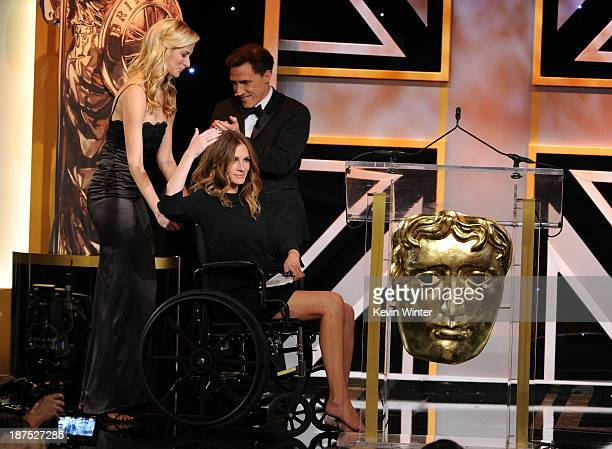 Actress Julia Roberts is wheeled onstage during the 2013 BAFTA LA Jaguar Britannia Awards presented by BBC America at The Beverly Hilton Hotel on...