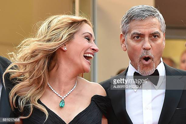 TOPSHOT US actress Julia Roberts laughs on May 12 2016 with US actor George Clooney as they arrive for the screening of the film 'Money Monster' at...