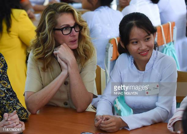 Actress Julia Roberts listens to Vietnamese students in Can Giuoc district, Long An province on December 9, 2019. - Michelle Obama and Julia Roberts...