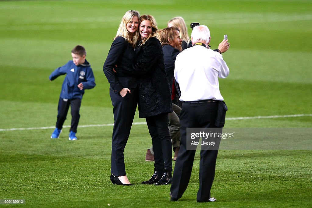 Actress Julia Roberts poses for a photo on the pitch after the Premier League match between Manchester United and West Ham United at Old Trafford on November 27, 2016 in Manchester, England.