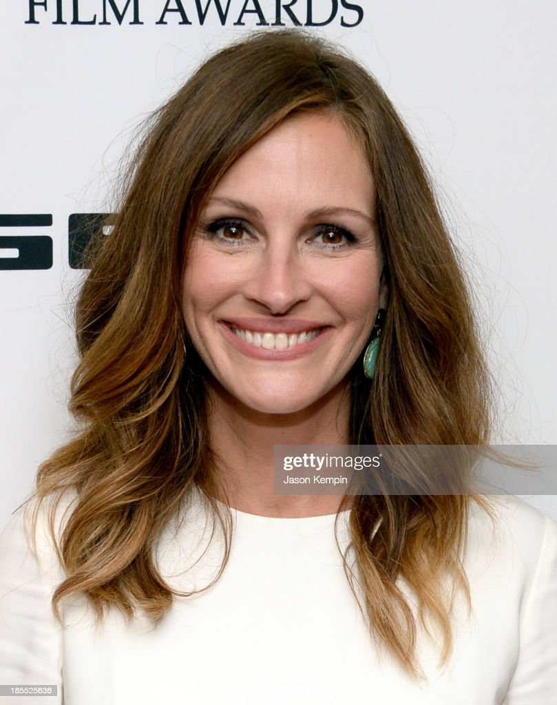 Actress Julia Roberts poses in the press room during the 17th annual Hollywood Film Awards at The Beverly Hilton Hotel on October 21, 2013 in Beverly Hills, California.