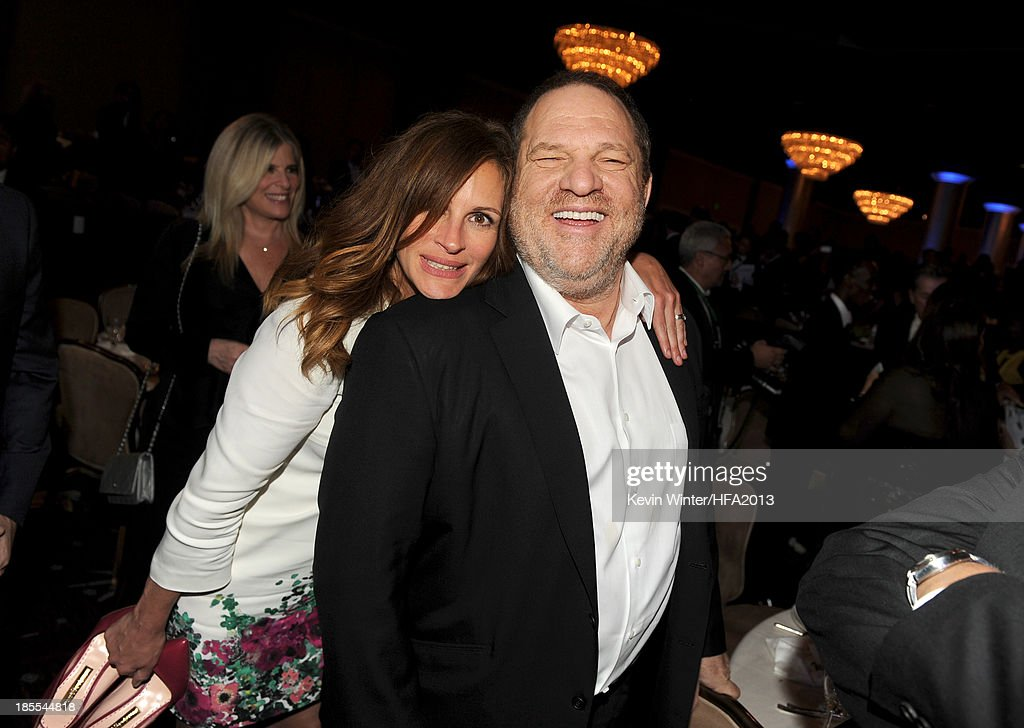 Actress Julia Roberts, recipient of the Hollywood Ensemble Cast Award for 'August: Osage County,' and producer Harvey Weinstein pose during the 17th annual Hollywood Film Awards at The Beverly Hilton Hotel on October 21, 2013 in Beverly Hills, California.