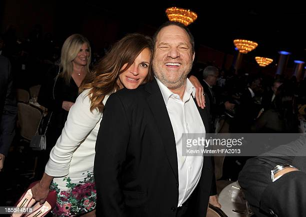 Actress Julia Roberts recipient of the Hollywood Ensemble Cast Award for 'August Osage County' and producer Harvey Weinstein pose during the 17th...
