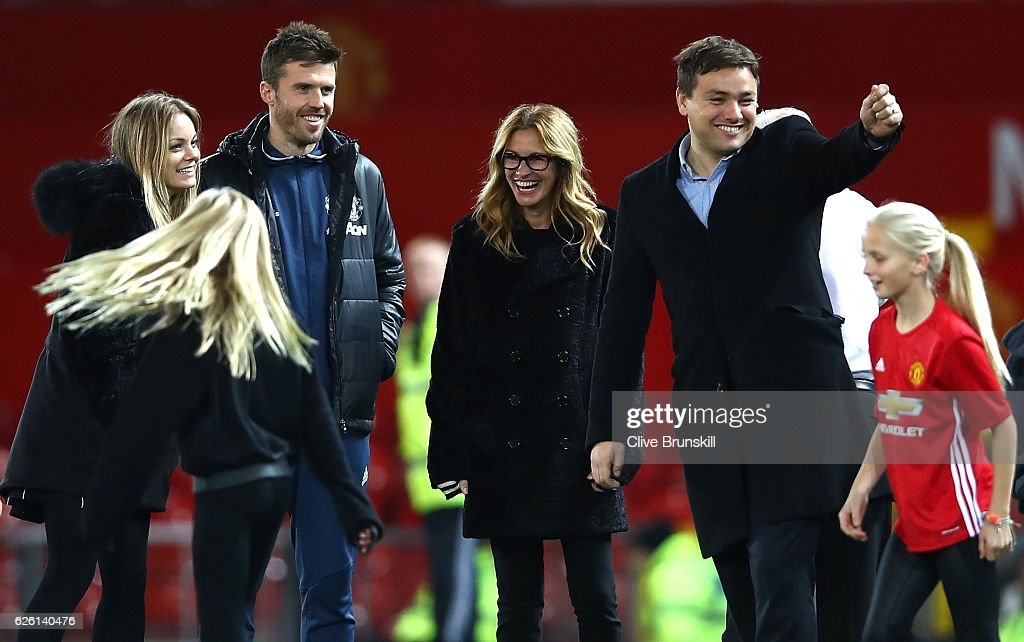 Actress Julia Roberts smiles with Michael Carrick (2ndL) of Manchester United after the Premier League match between Manchester United and West Ham United at Old Trafford on November 27, 2016 in Manchester, England.