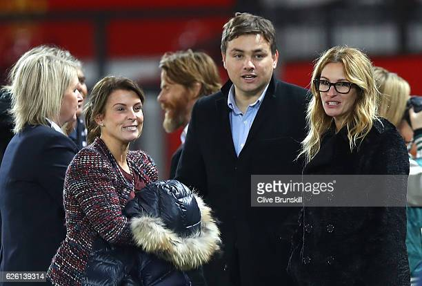 Actress Julia Roberts talks with Coleen Rooney after the Premier League match between Manchester United and West Ham United at Old Trafford on...