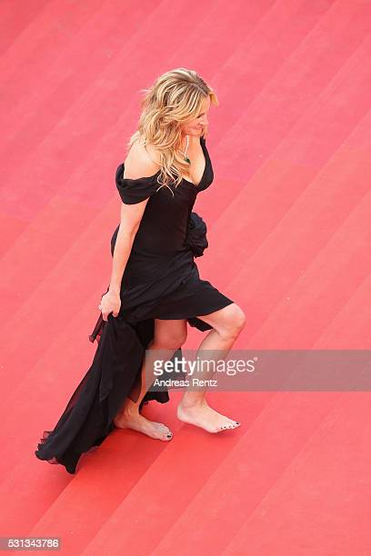 Actress Julia Roberts walks barefoot upon her arrival at the 'Money Monster' premiere during the 69th annual Cannes Film Festival at the Palais des...