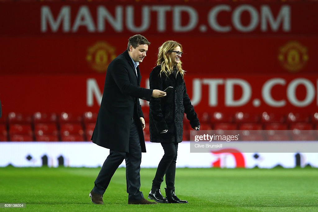 Actress Julia Roberts walks on the pitch after the Premier League match between Manchester United and West Ham United at Old Trafford on November 27, 2016 in Manchester, England.