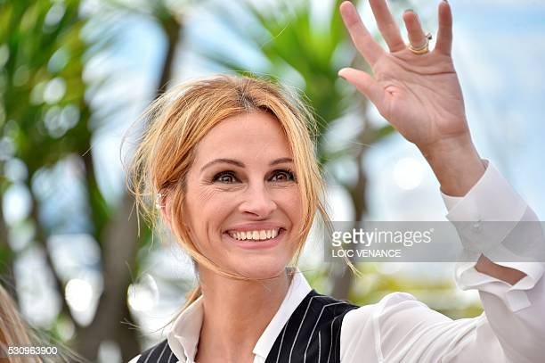 US actress Julia Roberts waves on May 12 2016 during a photocall for the film Money Monster at the 69th Cannes Film Festival in Cannes southern...