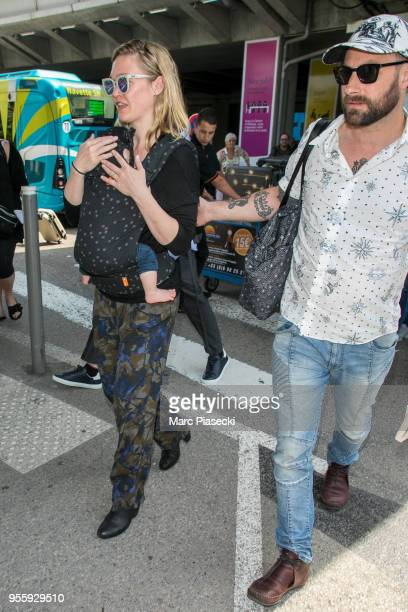 Actress Julia Stiles and Preston J Cook are seen during the 71st annual Cannes Film Festival at Nice Airport on May 8 2018 in Nice France