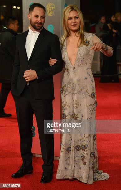 US actress Julia Stiles and Preston J Cook pose upon arrival at the BAFTA British Academy Film Awards at the Royal Albert Hall in London on February...