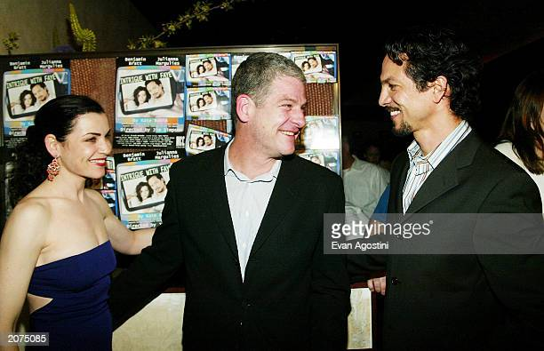 Actress Julianna Margulies director Jim Simpson and actor Benjamin Bratt pose together at MCC Theaters' opening night of Intrigue With Faye...