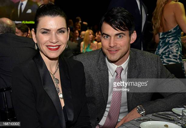 Actress Julianna Margulies left and husband Keith Lieberthal attend the Robin Hood Foundation Gala in New York US on Monday May 13 2013 The annual...