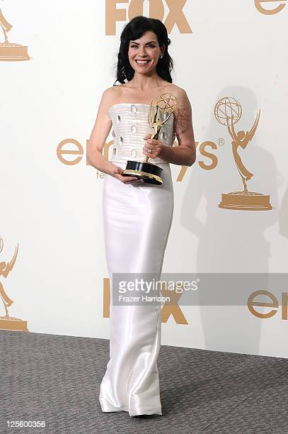 Actress Julianna Margulies of 'The Good Wife' poses in the press room after winning Outstanding Lead Actress in a Drama Series during the 63rd Annual...